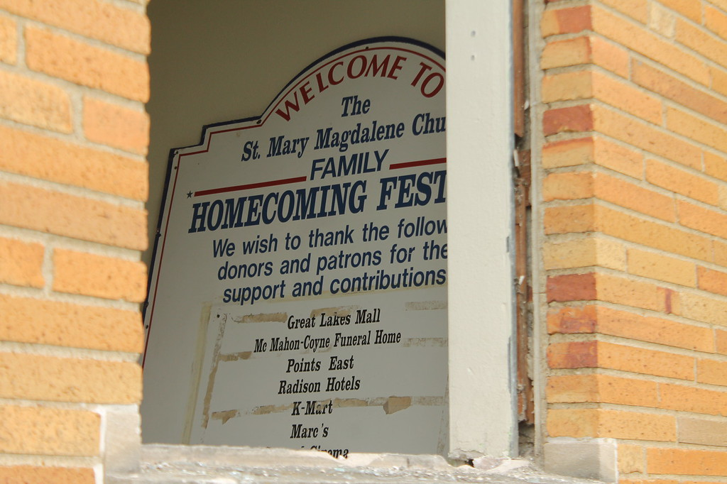 . A sign welcoming students to the homecoming dance is one of the few items left in The Grove (convent)  at Saint Mary Magdalene\'s in Willowick. The Grove  will be demolished after crews finish demolition on the rectory which was started June 11. Kristi Garabrandt - The News-Herald