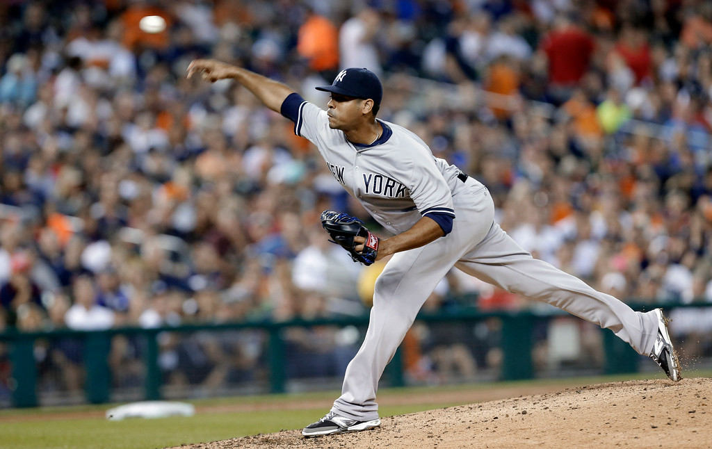 . New York Yankees relief pitcher Esmil Rogers throws against the Detroit Tigers in the seventh inning of a baseball game in Detroit Tuesday, Aug. 26, 2014. (AP Photo/Paul Sancya)