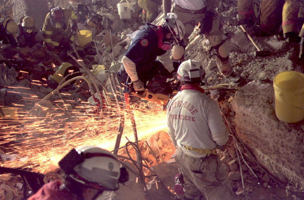 . Rescue workers cut through the ruble with a saw 29 April 1995, in the Federal Building, Oklahoma City, looking for survivors from the 19 April bombing. Work was halted during 29 April because of falling debris that was a danger to the rescuers.           (Roman BAS/AFP/Getty Images)