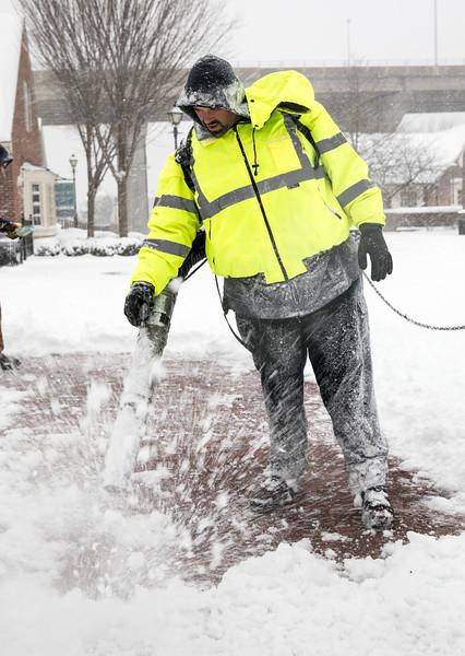 County Worker Blowing off Sidewalk.jpg