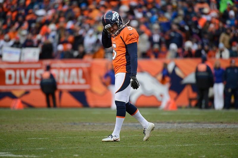 . Denver Broncos kicker Matt Prater (5) walks off the field after missing a field goal in the second quarter.  The Denver Broncos vs Baltimore Ravens AFC Divisional playoff game at Sports Authority Field Saturday January 12, 2013. (Photo by Tim Rasmussen,/The Denver Post)