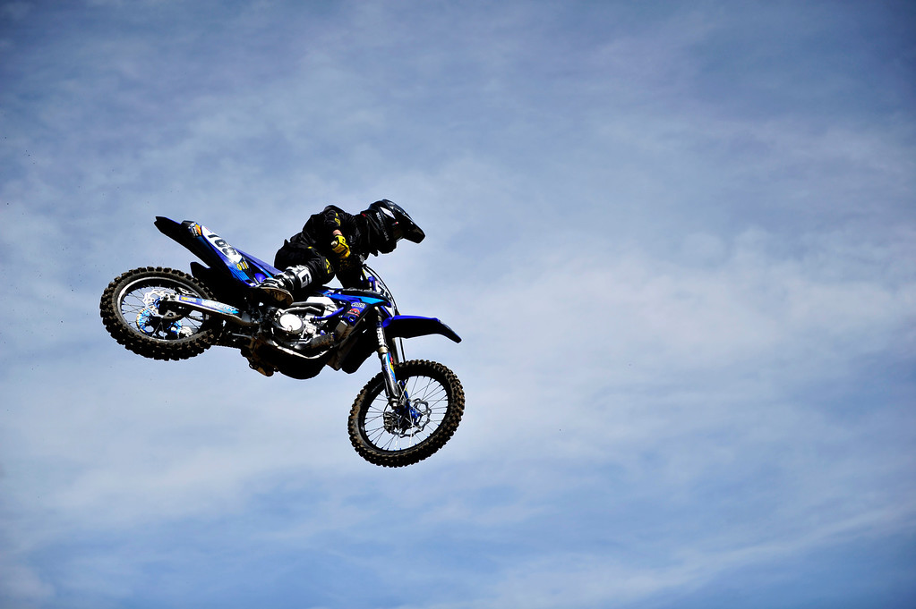 . Lakewood, CO. - MAY 23: #765 Mike Giese of Sedalia, Colo., flies through the air hitting a jump  during practice laps at the Thunder Valley Motocross Park in Lakewood, Colo. May 23, 2013. The practice was part of a media day event promoting coverage for the 2013 AMA Thunder Valley National the next day. (Photo By Manuel J. Martinez/The Denver Post)