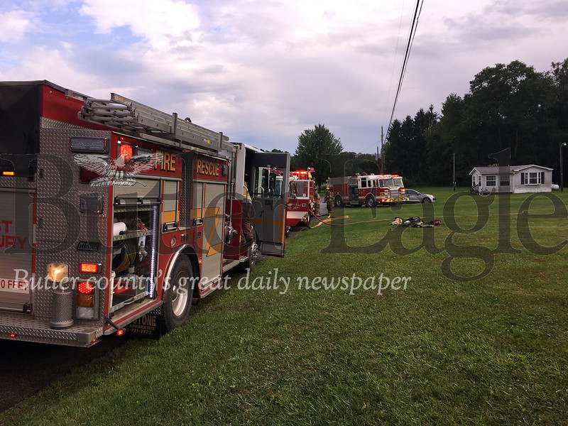 Four fire departments were called to a Clay Township fire that started in kitchen cabinet in a trailer home  Monday evening. Photos by Lauryn Halahurich