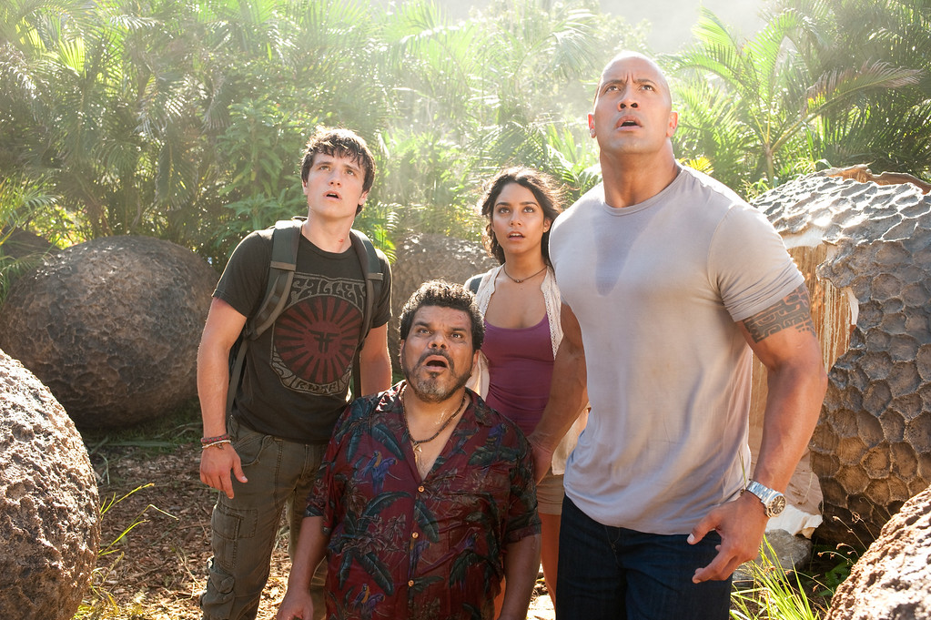 """. In this image released by Warner Bros. Pictures, from left, Josh Hutcherson, Luis Guzman, Vanessa Hudgens and Dwayne Johnson are shown in a scene from \""""Journey 2: The Mysterious Island.\"""" (AP Photo/Warner Bros. Pictures, Ron Phillips)"""
