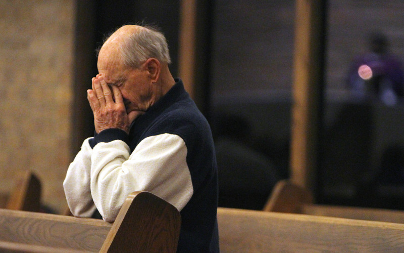 . A worshiper prays during morning mass at Sacred Heart Catholic Church on Thursday, Feb. 28, 2013 in Conroe, Texas. Pope Benedict XVI will become the first pontiff to resign in 600 years.  (AP Photo/ The Courier, Jason Fochtman)