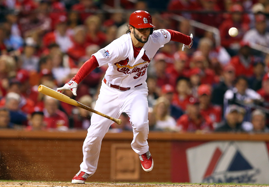 . Pete Kozma #38 of the St. Louis Cardinals runs on his sacrafice in the third inning moving David Freese #23 to second base during Game Five of the 2013 World Series at Busch Stadium on October 28, 2013 in St Louis, Missouri.  (Photo by Elsa/Getty Images)