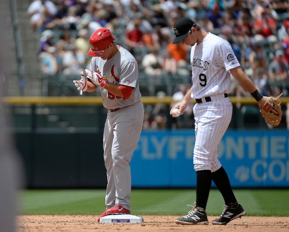 . St. Louis Cardinals starting pitcher Marco Gonzales (56) claps his hand standing on second base after his double to center field off of Colorado Rockies starting pitcher Yohan Flande (58) in the third inning June 25, 2014 at Coors Field. (Photo by John Leyba/The Denver Post)