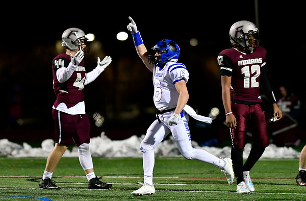 11/211/21/2018 Mike Orazzi | Staff Plainville's Christian Collin (6) during Wednesday night's football game at Farmington High School.