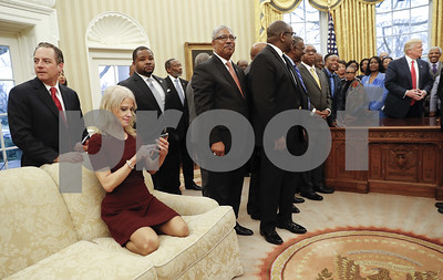 kellyanne-conway-kneels-on-oval-office-couch-sparks-debate