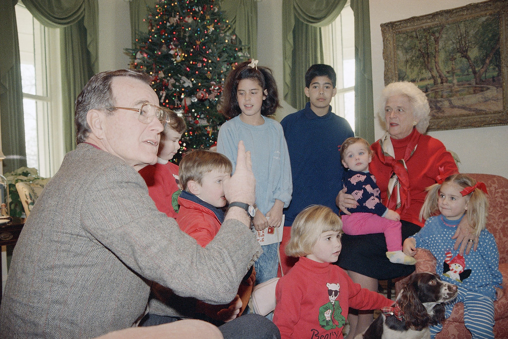 . Vice President George Bush, wife Barbara and family dog Millie gather with some of their ten grandchildren at the vice president\'s residence in Washington, Dec. 24, 1987. (AP Photo/Barry Thumma)