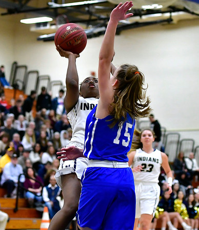 3/1/2019 Mike Orazzi | Staff Newington High School's Ashanti Frazier (10) and Glastonbury Tomahawks' Charlotte Bassett (10) during the Class LL Second Round of the CIAC 2019 State Girls Basketball Tournament at Newington High School Friday night.