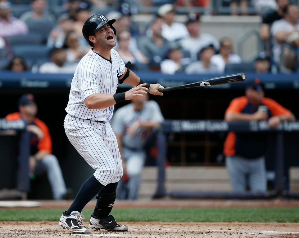 . New York Yankees\'  Francisco Cervelli reacts after flying out, stranding a runner, in the fourth inning of a baseball game against the Detroit Tigers at Yankee Stadium in New York, Thursday, Aug. 7, 2014.  (AP Photo/Kathy Willens)