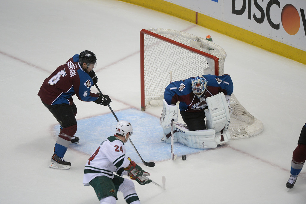 . Semyon Varlamov (1) of the Colorado Avalanche makes a save during the first period of action. At left are Erik Johnson (6) of the Colorado Avalanche and Matt Cooke (24) of the Minnesota Wild.  (Photo by Karl Gehring/The Denver Post)