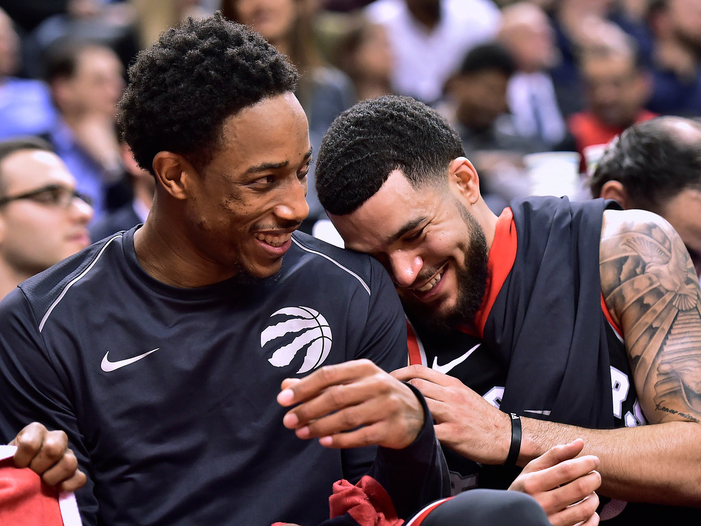 . Toronto Raptors guards DeMar DeRozan, left, and guard Fred VanVleet react on the bench during the second half of the team\'s NBA basketball game agains the Cleveland Cavaliers on Thursday, Jan. 11, 2018, in Toronto. (Frank Gunn/The Canadian Press via AP)