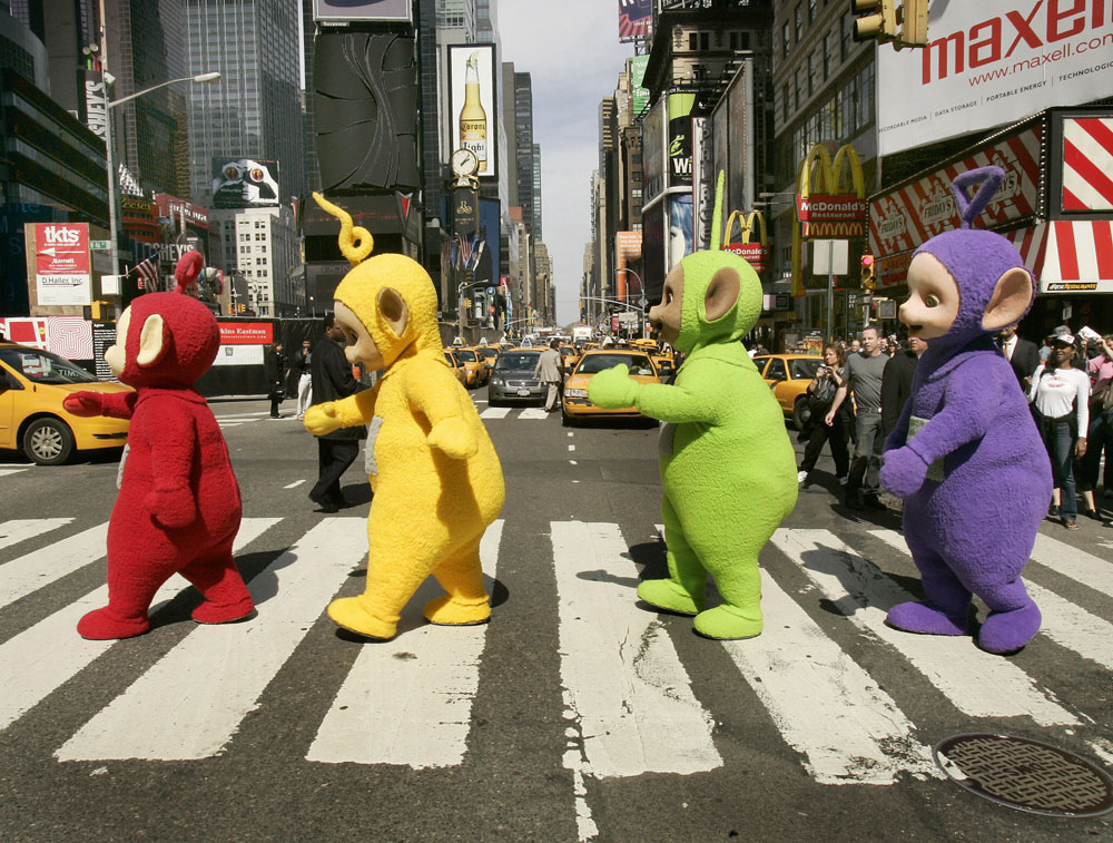 Description of . The world famous Teletubbies (L-R) Po, Laa-Laa, Dipsy and Tinky-Winky cross 7th Avenue in Times Square in New York 27 March 2007 as they arrive on American soil in person for the first time ever. The Teletubbies are visiting the city for the week for a number of events to mark their 10-year anniversary. AFP PHOTO Timothy A. CLARY