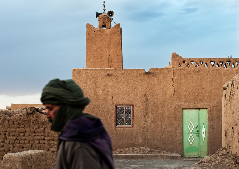 Local Man walking past the mosque at Hassi Labied, 