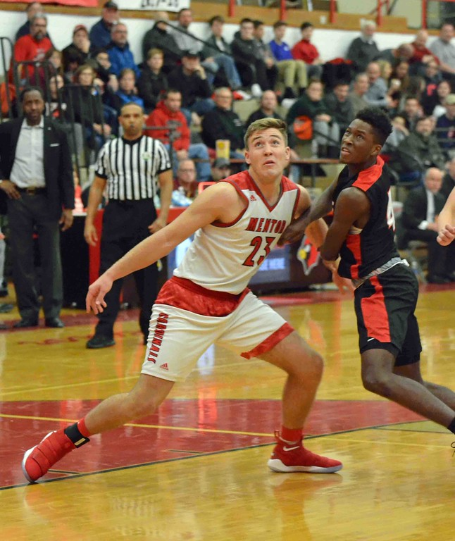 . Paul DiCicco - The News-Herald Action from Mentor-Shaker Heights boys basketball Dec. 15.