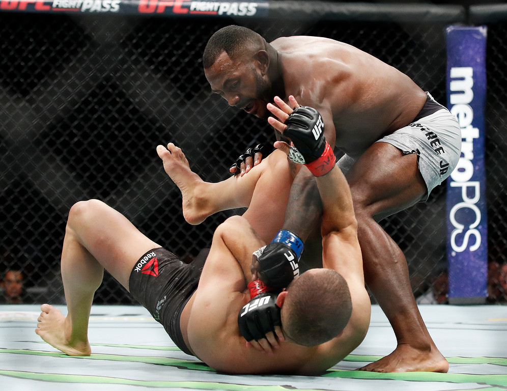 . Khalil Rountree Jr., right, fights Gokhan Saki in a light heavyweight mixed martial arts bout at UFC 226, Saturday, July 7, 2018, in Las Vegas. (AP Photo/John Locher)