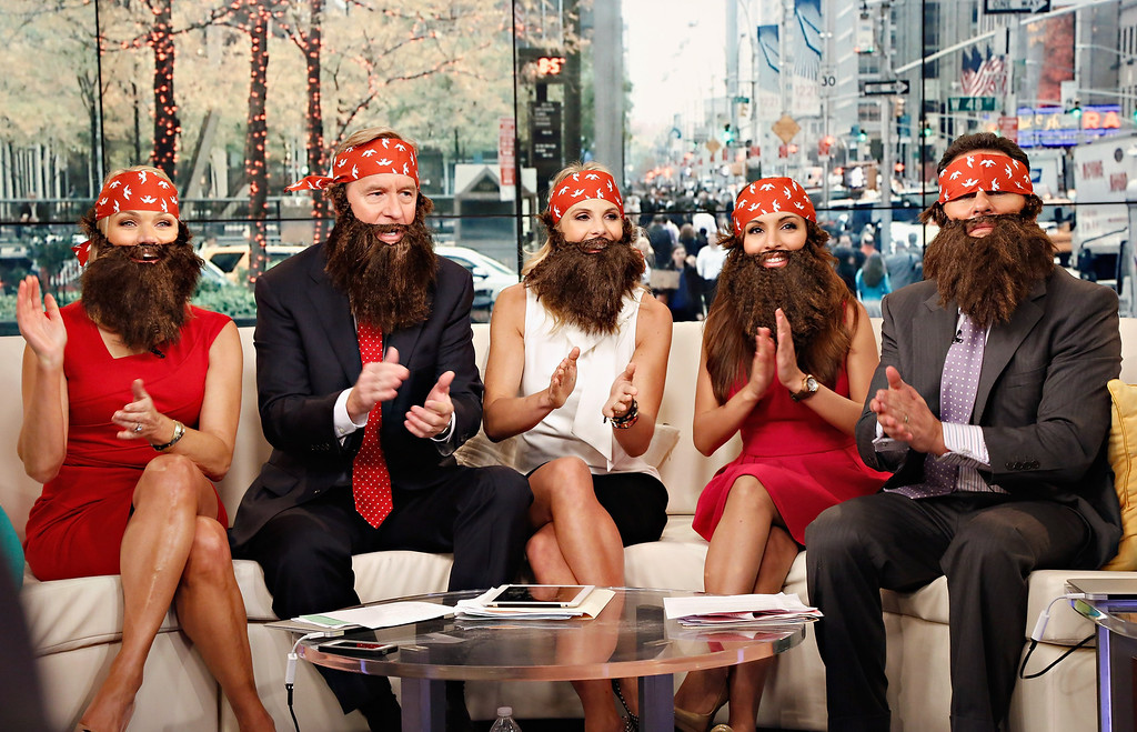 """. Hosts Heather Childers, Steve Doocy, Elisabeth Hasselbeck, Brian Kilmeade and Maria Molina wear \'Duck Dynasty\' costumes as \""""FOX & Friends\"""" celebrates Halloween at FOX Studios on October 31, 2013 in New York City.  (Photo by Cindy Ord/Getty Images)"""