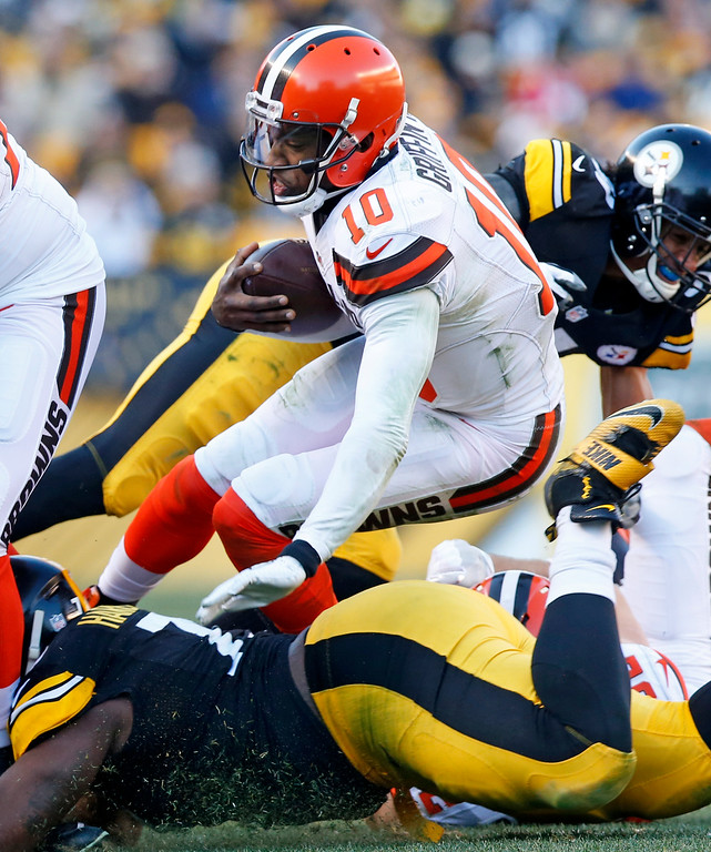 . Cleveland Browns quarterback Robert Griffin III (10) is tackled after a run during the second half of an NFL football game against the Pittsburgh Steelers in Pittsburgh, Sunday, Jan. 1, 2017. (AP Photo/Jared Wickerham)