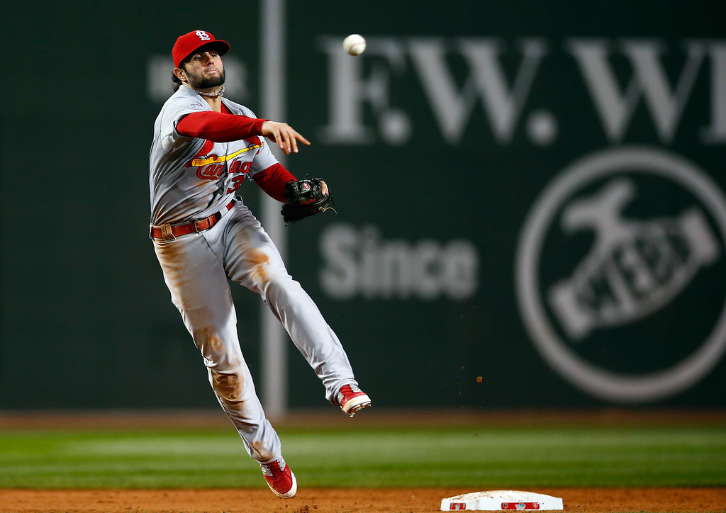 . BOSTON, MA - OCTOBER 24:  Pete Kozma #38 of the St. Louis Cardinals throws to first base in the seventh inning against the Boston Red Sox during Game Two of the 2013 World Series at Fenway Park on October 24, 2013 in Boston, Massachusetts.  (Photo by Jared Wickerham/Getty Images)