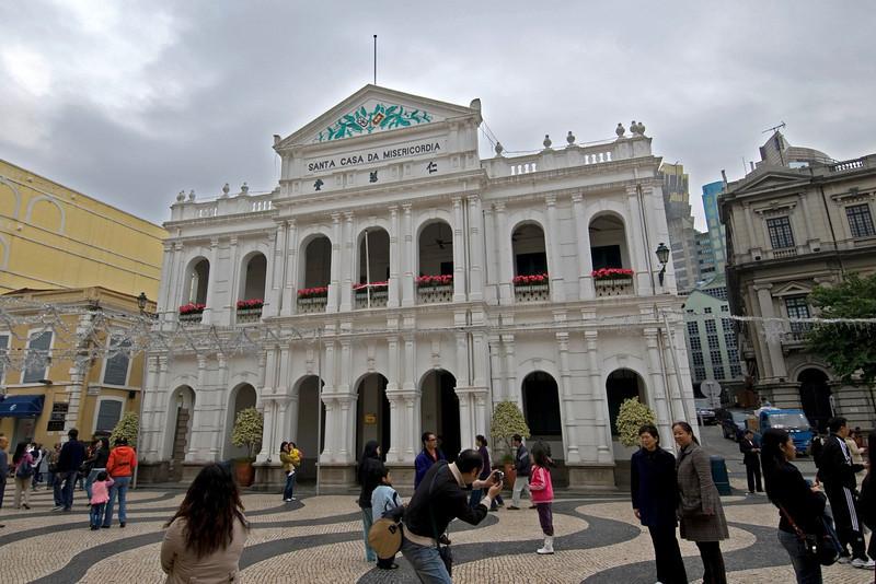 Tourists posing in front of Santa Casa de Misericordia in Macau