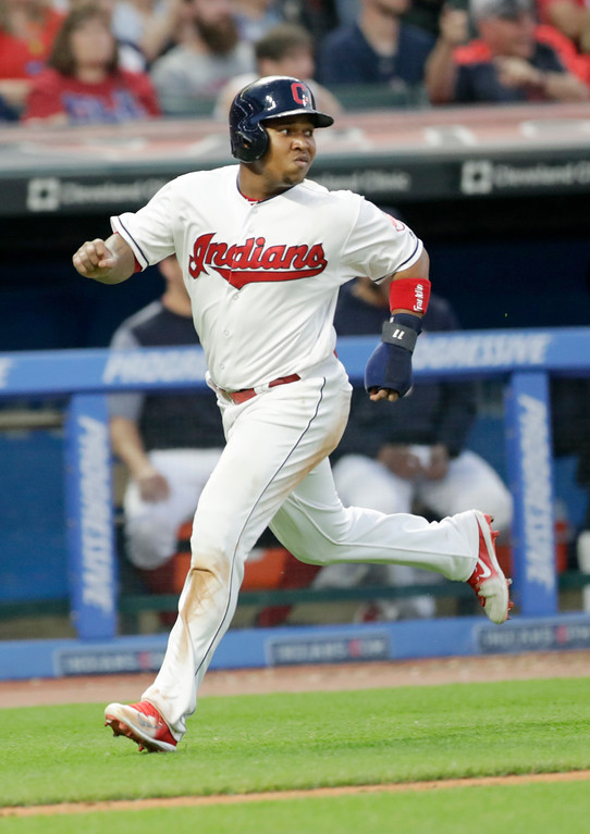 . Cleveland Indians\' Jose Ramirez scores in the sixth inning of a baseball game against the Minnesota Twins, Friday, June 15, 2018, in Cleveland. (AP Photo/Tony Dejak)