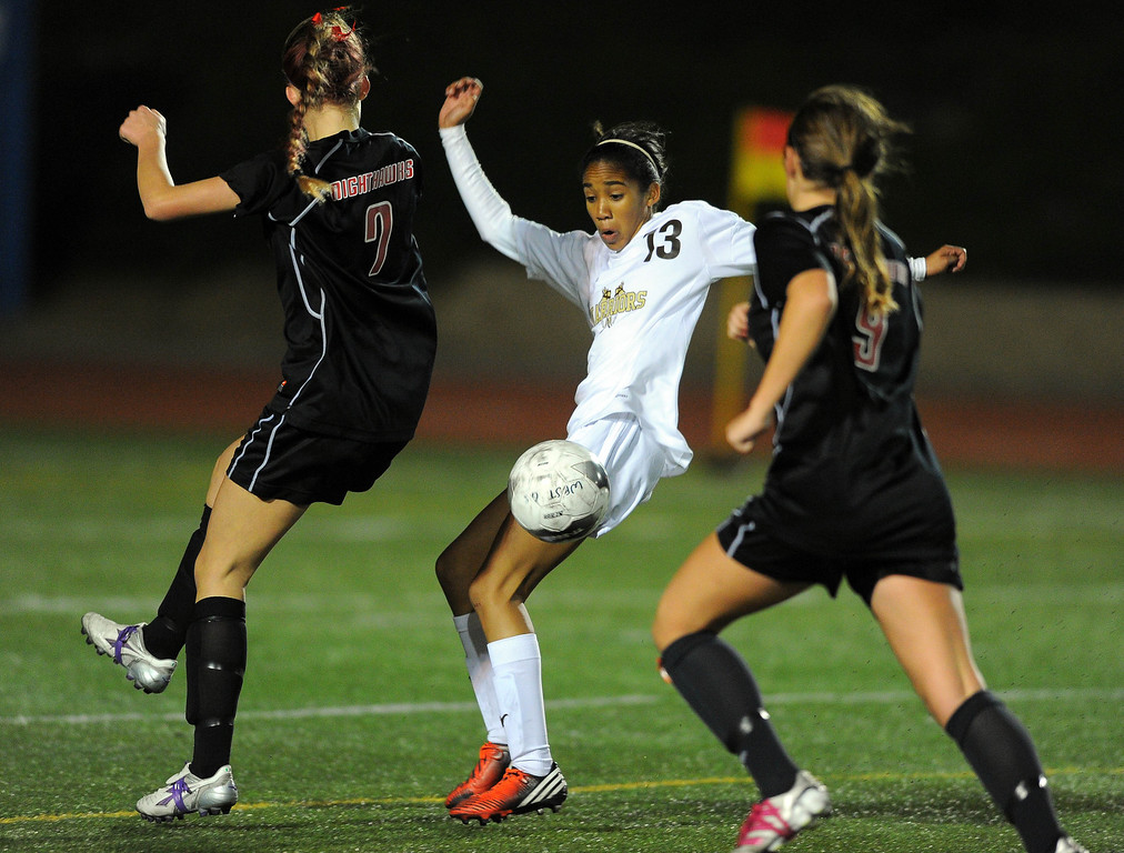 . TORRANCE - 02/12/2013 - (Staff Photo: Scott Varley/LANG) West High girls soccer beat Murrieta Valley on penalty kicks in their CIF Southern Section Division II wild-card matchup. After a 0-0 tie, West won 3-1 on PKs. West\'s Zoe Anderson, center, tries to control the ball between Hayden Kelley, left, and Sarah Ramano.