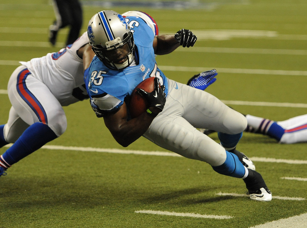 . Detroit Lions running back Joique Bell dives for yardage against the Buffalo Bills during fourth quarter action.  The Lions beat the Bills, 38-32.  Photo taken on Thursday, August 30, 2012, at Ford Field in Detroit, Mich.  (Special to The Oakland Press/Jose Juarez)