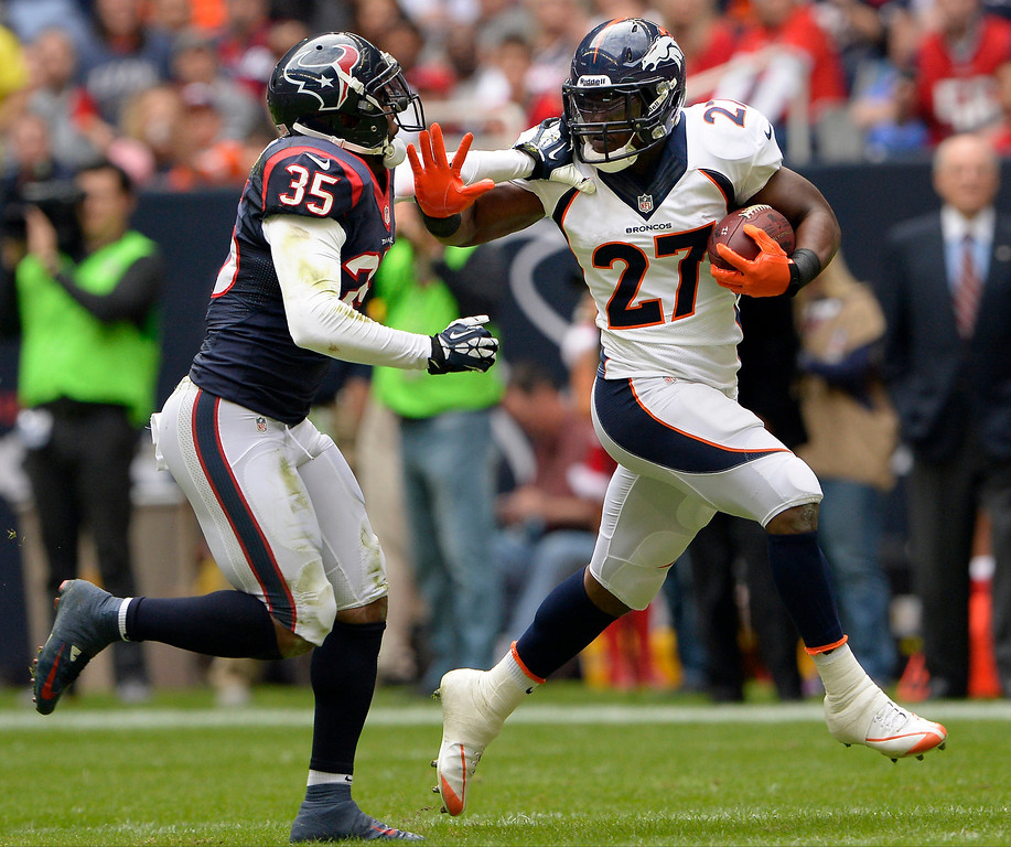 . Running back Knowshon Moreno #27 of the Denver Broncos breaks into the secondary against  the Houston Texans at Reliant Stadium December 22, 2013 Houston, Texas. (Photo By Joe Amon/The Denver Post)