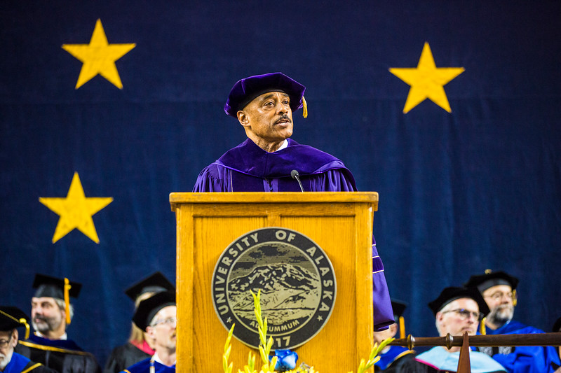 Vice Chancellor for Student Affairs Keith Champagne introduces the 2018 class speaker, Aaron T. Cottle, during UAF's commencement ceremony at the Carlson Center on May 5, 2018.