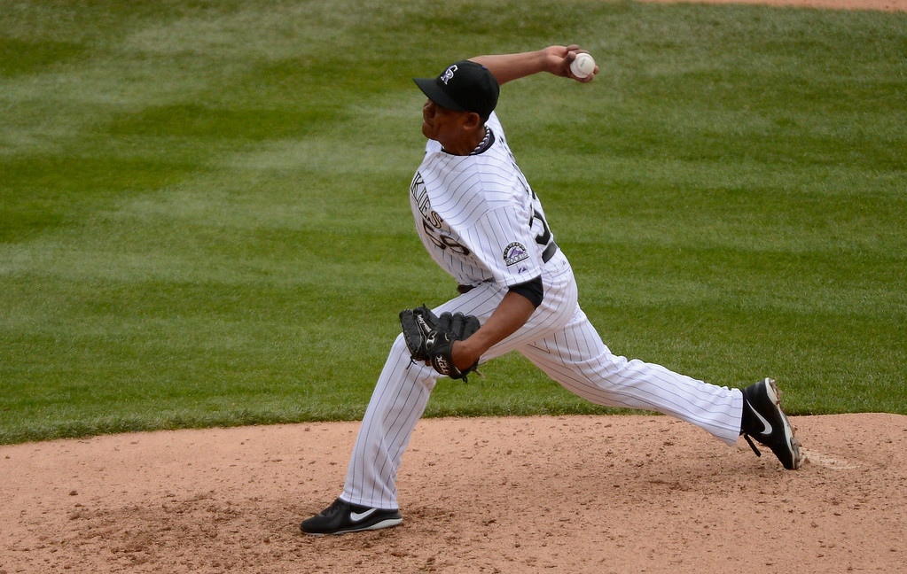 . DENVER, CO. - APRIL 21: Wilton Lopez (59) of the Colorado Rockies delivers a pitch in the ninth inning agains the Arizona Diamondbacks April 21, 2013 at Coors Field. The DiamondBacks snapped the Rockies 8 game winning streak at home with a 5-4 win. (Photo By John Leyba/The Denver Post)