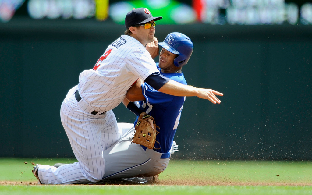 . Royals base runner Justin Maxwell  is out at second base as Minnesota\'s Brian Dozier turns a double play to end the top half of the second inning. (Photo by Hannah Foslien/Getty Images)