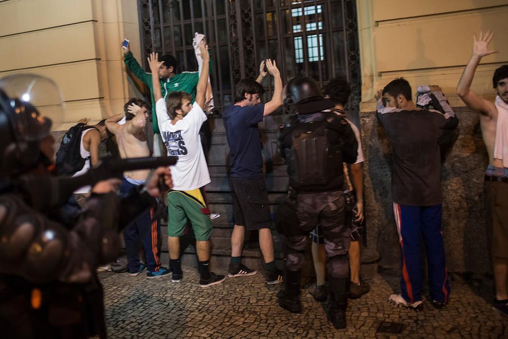 . Riot police search protestors during an anti-government demonstration in Rio de Janeiro, Brazil, Thursday, June 20, 2013.  (AP Photo/Felipe Dana)