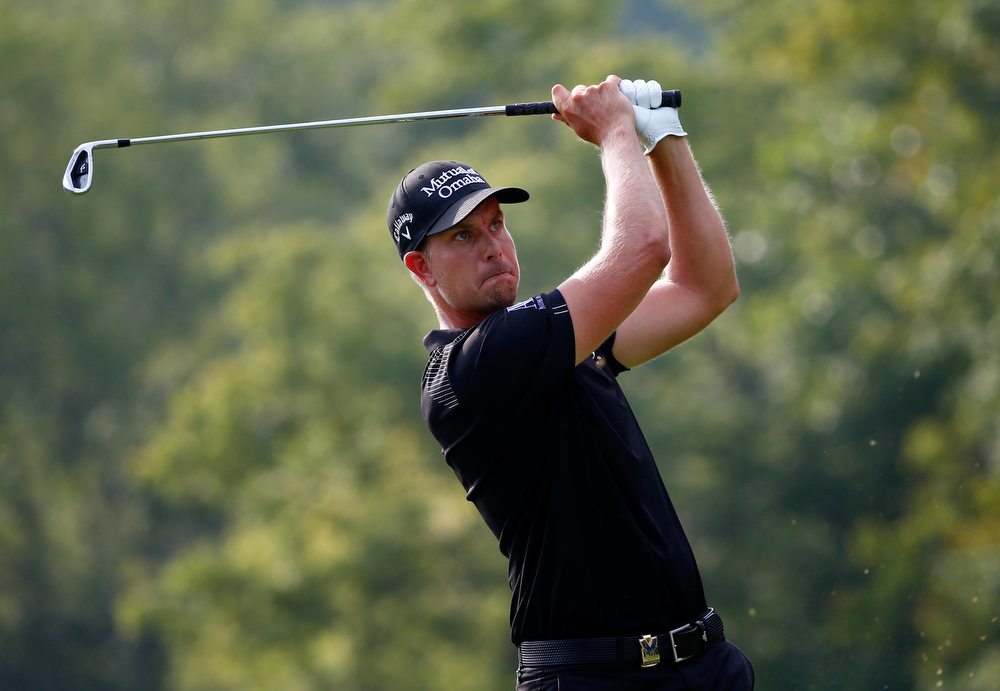 . Henrik Stenson of Sweden hits his tee shot on the eighth hole during the final round of the 96th PGA Championship at Valhalla Golf Club on August 10, 2014 in Louisville, Kentucky.  (Photo by Sam Greenwood/Getty Images)