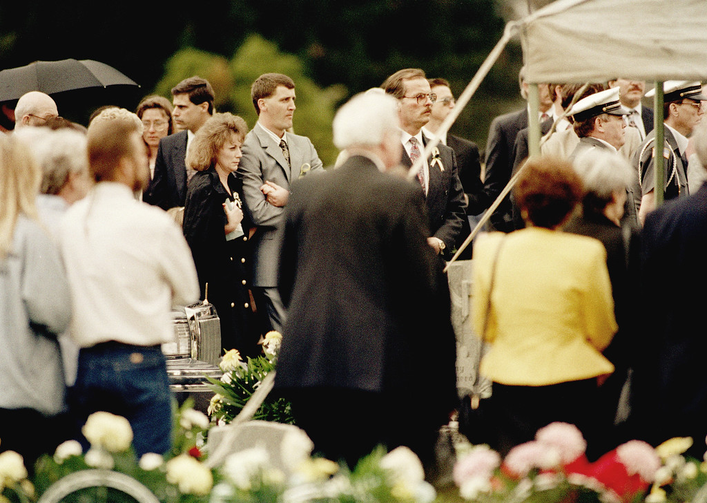 . Peggy Vallandingham, dark coat, wife of prison guard Robert Vallandingham, is escorted to her husband\'s funeral in Portsmouth, Ohio, April 19, 1993. Vallandingham was killed during a prison riot at the Southern Ohio Correctional Facility in Lucasville, Ohio. About 450 inmates have held a cellblock since April 11, when the rioting first broke out. (AP Photo/Al Behrman)