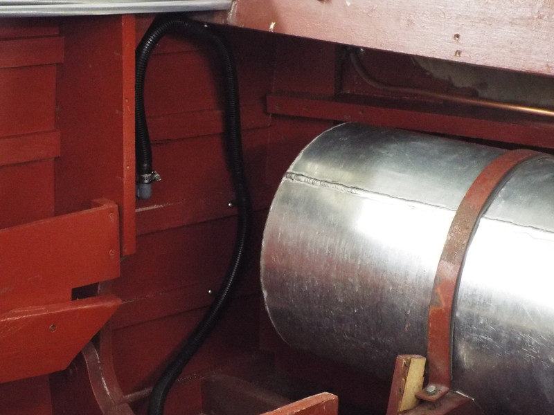 Rear bilge pump now through the starboard side instead of the transom as it was before the restoration.