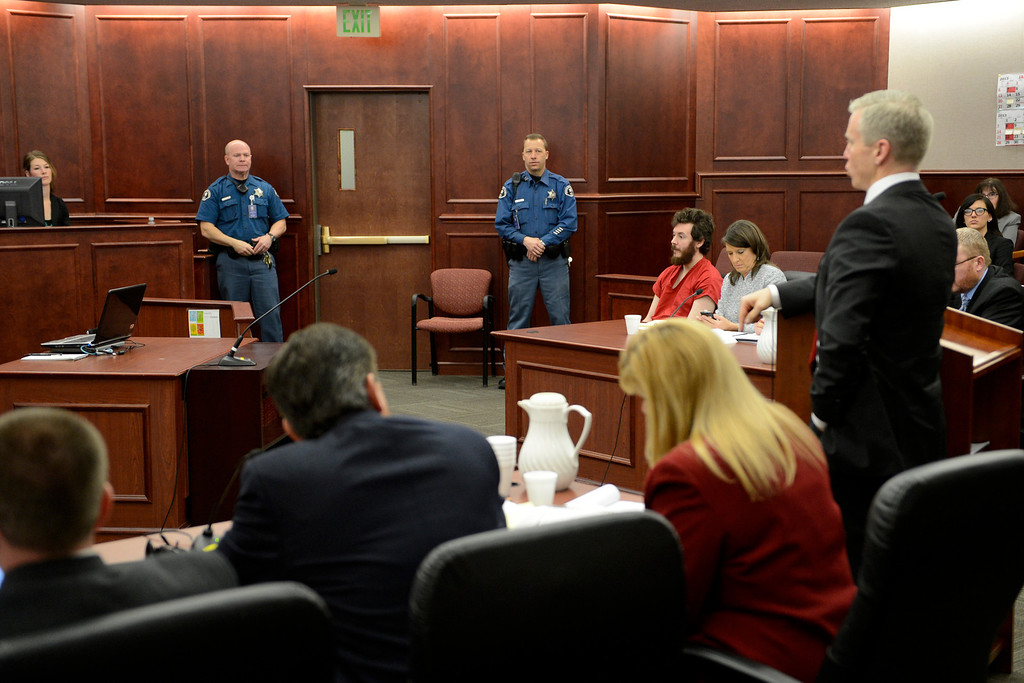 . The prosecution team at their table during the proceedings where District Court Judge William Sylvester entered a Not Guilty plea on behalf of Holmes. The trial is set to begin August 5, 2013. (Photo By RJ Sangosti/The Denver Post)