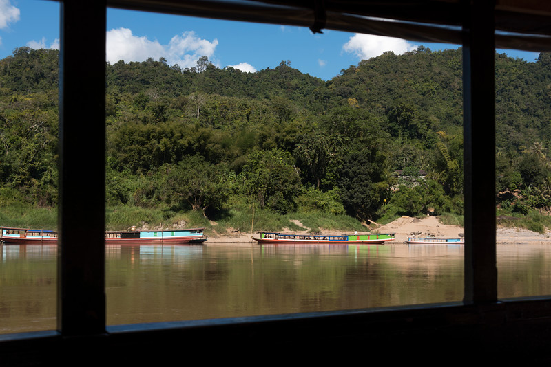 Boats in river seen through from window, River Mekong, Laos