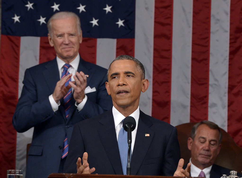. President Barack Obama delivers his State of the Union address to a joint session of Congress on Capitol Hill on Tuesday, Jan. 20, 2015, in Washington, as Vice President Joe Biden applauds and House Speaker John Boehner of Ohio, listens. (AP Photo/Mandel Ngan, Pool)