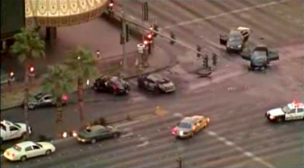 . Police cars attend the scene of an early morning shooting February 21, 2013 on the Strip in Las Vegas, Nevada in this video screen grab from KSNV-TV. At lest three people are dead, and four more are in the hospital, police said. Seven cars were involved in the shooting incident and subsequent collisions. REUTERS/KSNV-TV/Handout