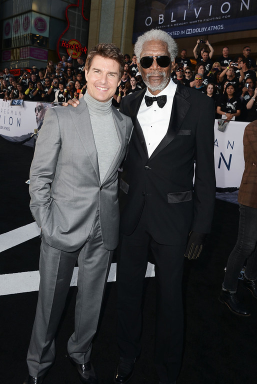 """. Actors Tom Cruise and Morgan Freeman arrive at the premiere of Universal Pictures\' \""""Oblivion\"""" at Dolby Theatre on April 10, 2013 in Hollywood, California.  (Photo by Kevin Winter/Getty Images)"""