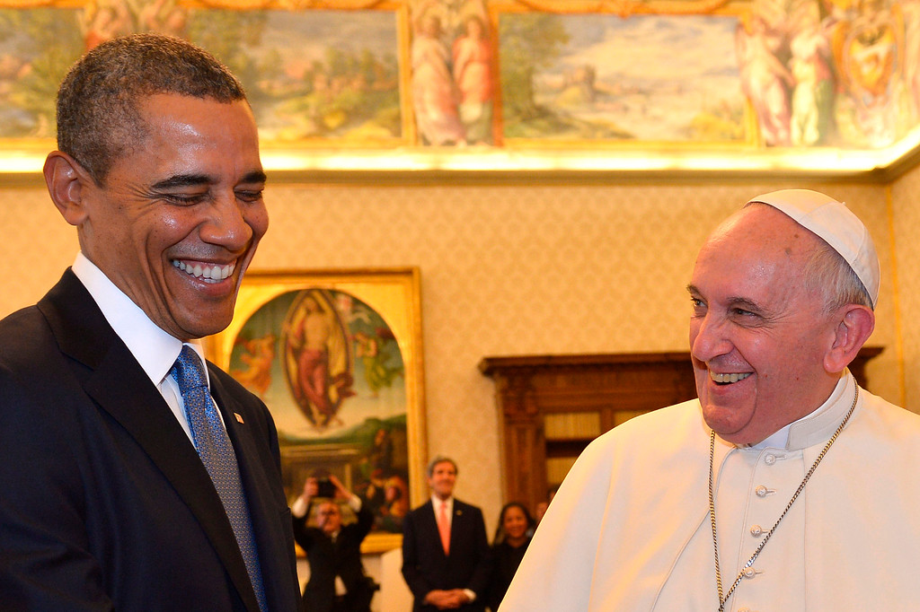 . Pope Francis and President Barack Obama smile as they meet at the Vatican Thursday, March 27, 2014. A visibly energized President Barack Obama held a nearly hourlong audience with Pope Francis at the Vatican, expressing his great admiration for the pontiff and inviting him to visit the White House. (AP Photo/Gabriel Bouys, File Pool)