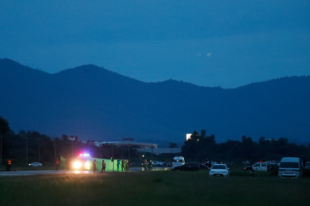 . An ambulance waiting for arrival of helicopter of the rescued boys from the flooded cave, in the Mae Sai district of Chiang Rai province, northern Thailand, Monday, July 9, 2018. (AP Photo/Vincent Thian)