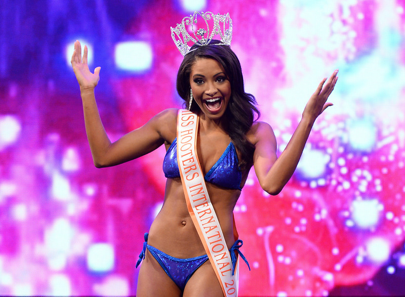 . Marissa Raisor of Newport, Kentucky poses onstage after being crowned Miss Hooters International 2013 at the 17th annual Hooters International Swimsuit Pageant at The Joint inside the Hard Rock Hotel & Casino on June 27, 2013 in Las Vegas, Nevada.  (Photo by Ethan Miller/Getty Images)