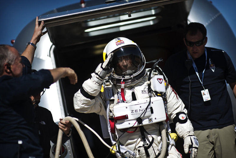 ". In this handout from Red Bull Stratos, Pilot Felix Baumgartner of Austria salutes on his way to the capsule before the final manned flight for Red Bull Stratos October 9, 2012 in Roswell, New Mexico. on . Baumgartner was to attempt a record setting skydive from 23 miles above the Earth, but the attempt had to be aborted due to gusty winds.  ""Stratosphere jump\"" ranked as Google\'s seventh most searched trending event of 2012. (Photo by Red Bull Stratos via Getty Images)"