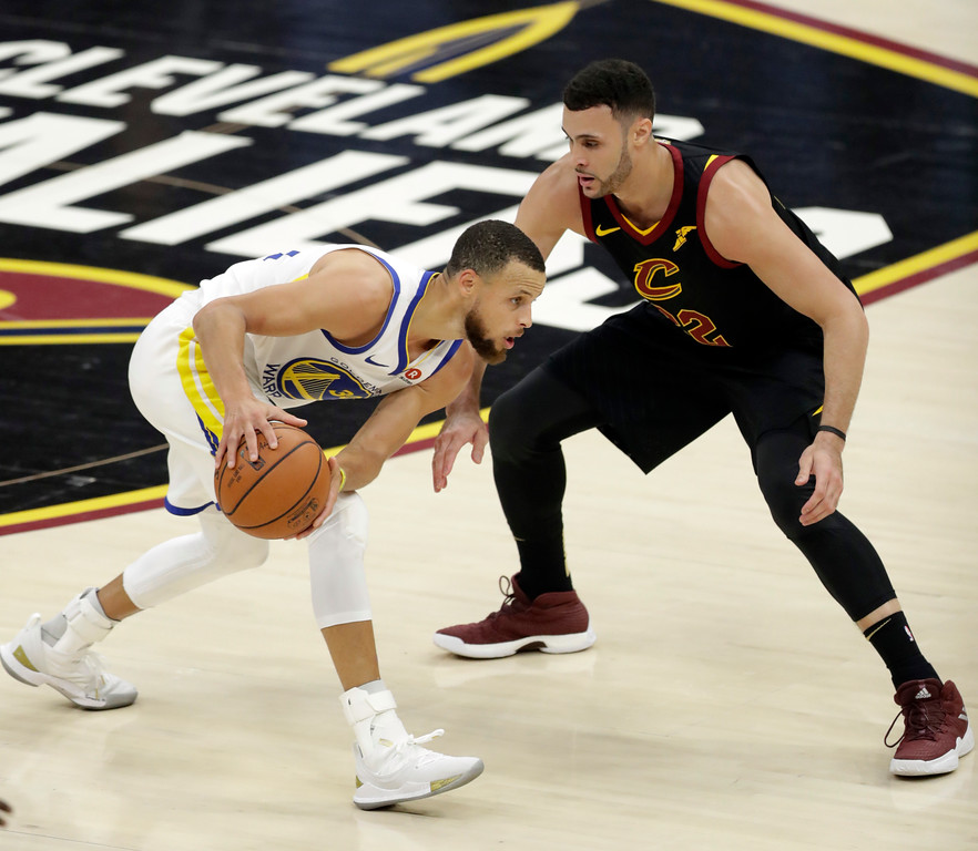 . Golden State Warriors\' Stephen Curry is defended by Cleveland Cavaliers\' Larry Nance Jr. during the first half of Game 4 of basketball\'s NBA Finals, Friday, June 8, 2018, in Cleveland. (AP Photo/Tony Dejak)