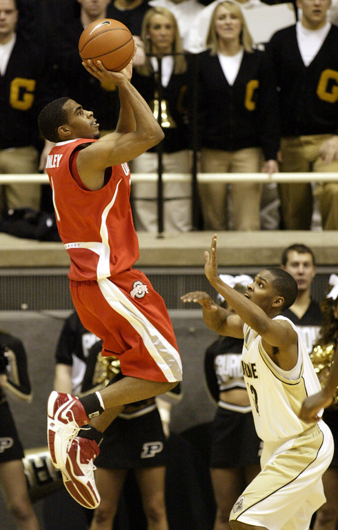 . Ohio State\'s Mike Conley, left, puts up a shot over Purdue\'s Tarrance Crump, right, during the second half of a college basketball game in West Lafayette, Ind., Wednesday, Jan. 31, 2007. (AP Photo/Tom Strattman)