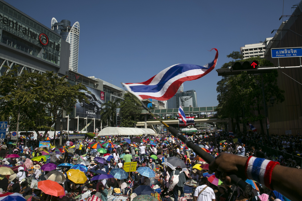 """. Anti-government protesters occupy a major intersection in downtown Bangkok on the first day of the \"""" Bangkok Shutdown \"""", Thailand on January 13, 2014. Anti-government protesters launch \""""Bangkok Shutdown\"""", blocking major intersections in the heart of the capital, as part of their bid to oust the government of Prime Minister Yingluck Shinawatra ahead of elections scheduled to take place on February 2. (Photo by Paula Bronstein/Getty Images)"""