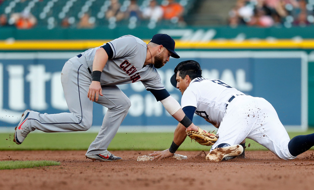 . Detroit Tigers\' Mikie Mahtook, right, steals second base ahead of the tag by Cleveland Indians second baseman Jason Kipnis in the third inning of a baseball game in Detroit, Monday, May 14, 2018. (AP Photo/Paul Sancya)